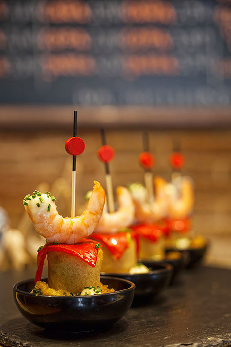 PINTXO - Black rice and squid wrap with langoustine and stuffed olive and a hint of garlic mayo