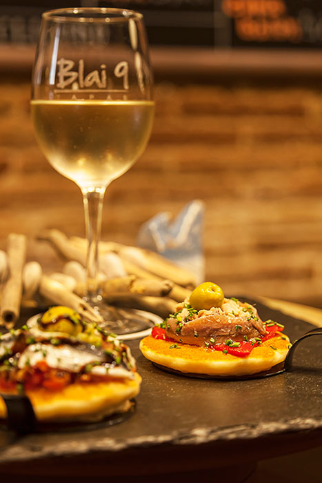 """PINTXO - Pancake with anchovies, """"piquillo"""" red peppers, olive paste and balsamic vinegar"""