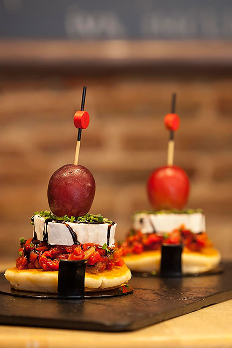 PINTXO - Pancake with roast vegetables and goat's cheese, balsamic vinegar and grape
